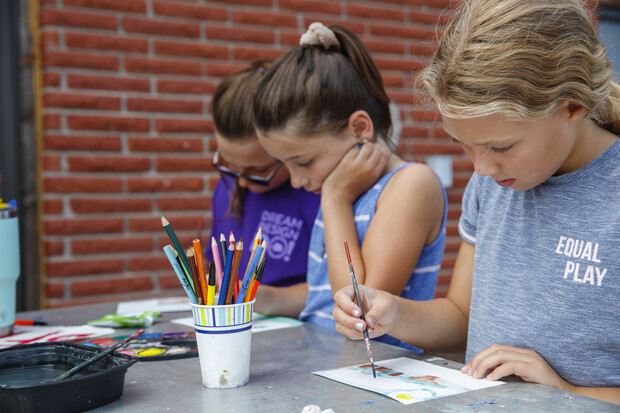 Campers work on art projects.