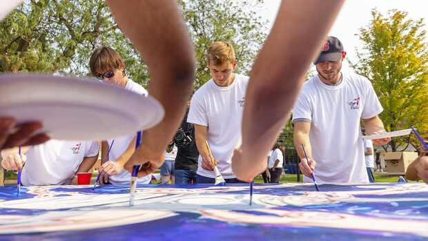Students paint The Palette Project's first mural, a rocket, on campus on Sept.1.