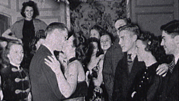 A couple kisses as students look on during the Delta Upsilon Christmas party in 1939. As part of its 50th anniversary, the University Archives and Special Collections is expanding its historic records from Recognized Student Organizations.