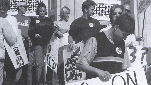 Nebraska students stand on the steps of the Nebraska Union during a protest of Initiative 413 in this image from 1999. The measure, which failed, proposed to reduce government spending by limiting the amount of tax revenue available for state and local governments to spend. This protest was organized by the Association of Students of the University of Nebraska.