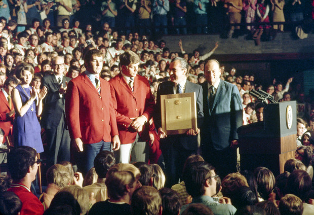 President Richard Nixon honored the Huskers 1970 national championship football team with the presentation of a presidential plaque during a Jan. 14, 1971 celebration in the Coliseum. Nixon (holding the plaque) presented the award to (from left) team captains Jerry Murtaugh and Dan Schneiss, and to head coach Bob Devaney.