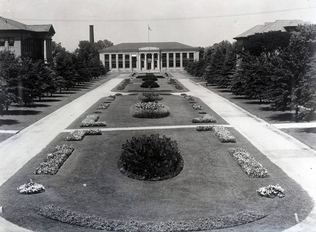 The East Campus Mall, looking north toward Chase Hall, featured flower beds in this image from the 1920s.