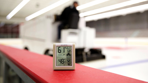 A monitor alongside the rink monitors air temperature and humidity inside UNL's John Breslow Ice Hockey Center. The facility features a system that balances temperature and humidity to improve the quality of the ice.