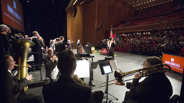 Jamie Reimer sings while the University of Nebraska Brass Quintet plays the National Anthem at the start of the installation ceremony for Chancellor Ronnie Green. The event was April 6 at the Lied Center for Performing Arts.