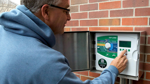 UNL's Fred Thorne tests a new irrigation system. The system can be controlled on site or via a specialized computer program.