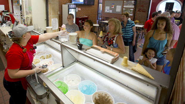UNL Dairy Store employee Katherine Mudorf serves ice cream to patrons during happy hour on July 8. The East Campus ice cream shop is open daily from 11 a.m. to 9 p.m.