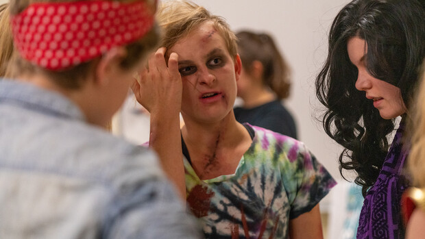 """Honors students assess a zombie during the """"Learn to Walk Like a Zombie"""" event on Oct. 29."""
