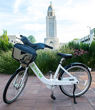 The BikeLNK service will feature three-speed cruisers with a basket and safety lights. The service will be available in April.