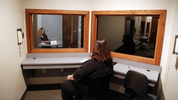 Deb Hope (center), Aaron Douglas professor of psychology and faculty clinic supervisor, watches Brenna Lash, a graduate student, from an observation room at the Psychological Counseling Center.