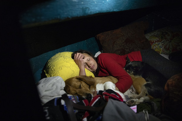 """Kristina cuddles her dogs whenshe goes to sleep at night. """"My dogs are everything, really,"""" she said. """"They're my kids. They're my family. They're my support group."""""""