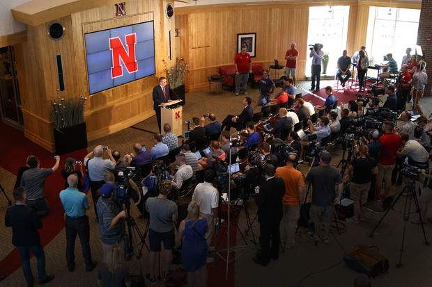 Media and members of the campus community listen to the Sept. 21 press conference announcing the start of a search for a new athletics director.