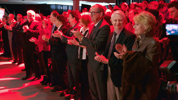 "Members of Johnny Carson's family and the Carson Foundation applaud as ""March of the Cornhuskers"" was played during the Nov. 6 gift announcement. Pictured (from right) is Karlyn Carson, Dick Carson, Jeff Sotzing, Peggy Sotzing, Larry Witzer, Allan Alexander and Larry Heller."