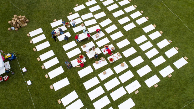 Volunteers start arrange panels at the start of the Guinness Book of World Records attempt on Aug. 31.