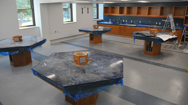 """Life sciences lab space in the remodeled Brace Labs features """"island' work stations that foster collaboration and interactive learning."""