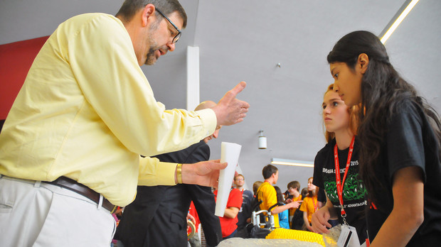 UNL's Tim Gay, professor of physics, works with Omaha-area science students during the build portion of the May 15 egg drop competition. Organized by UNL, the egg drop was part of the 2015 Science Olympiad National Tournament.
