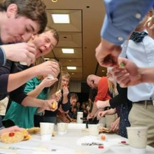 Students race to eat their edible vehicles at the close of a previous Incredible, Edible Vehicle Competition.