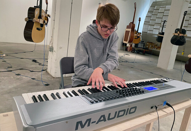 """Luke Farritor plays the """"Soundtracks for the Present Future"""" keyboard in the Bemis Center. Farritor is a sophomore in Nebraska's Jeffrey S. Raikes School of Computer Science and Management."""