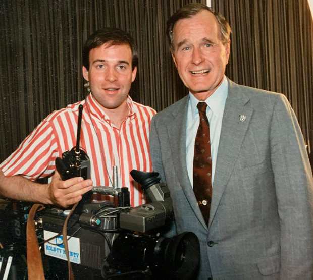 Nebraska's Dave Fitzgibbon, then a videographer with KOLN, poses with President George H.W. Bush during the 1998 campus visit. The photo was taken by a White House photographer.