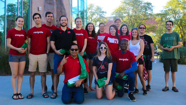 Go Green for Big Red volunteers pose for a photo during the 2018 season. Prabhakar Shrestha, the university's recycling coordinator, is pictured in the front row (kneeling), at left.
