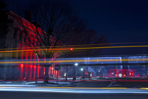 A StarTran bus cruises by Agriculture Hall and the East Campus Mall during the Feb. 14 Glow Big Red event.