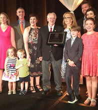 Surrounded by family, Dee Griffin (center) accepts the Industry Leadership Award from the Cattle Feeders' annual banquet.
