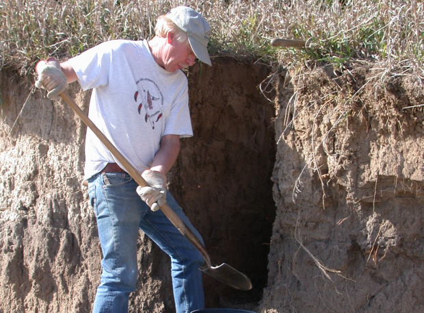 Archeologist Steven Holen at work at a dig site