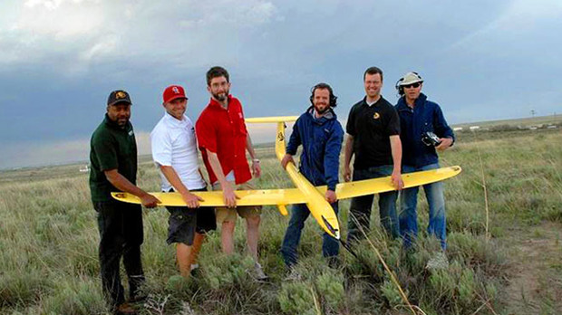 UNL's Adam Houston (third from left) stands with members of the Vortex 2 unmanned aircraft system group and the Tempest unmanned aircraft. Houston is an associate professor of atmospheric sciences at UNL.