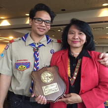 Roz Hussin (left) stands with her son after receiving the Whitney M. Young Jr. service award from the Boy Scouts of America.