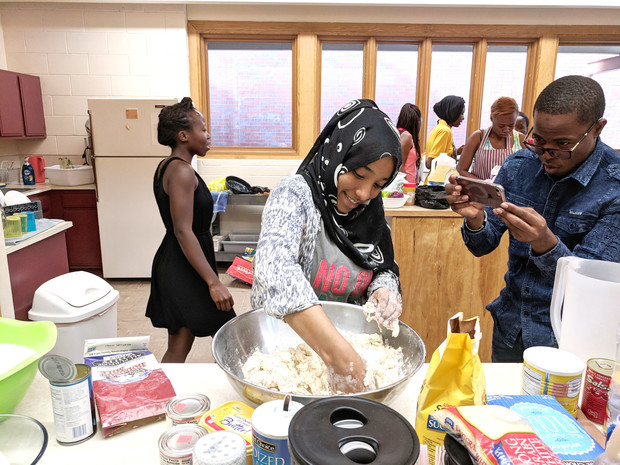 The Mandela Fellows celebrated America's Independence Day by making popular foods from their home countries for a potluck picnic at St. Mark's On-The-Campus.
