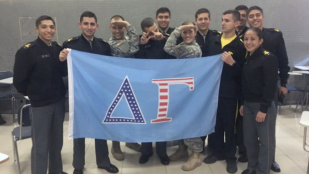 Nebraska's Molly Murphy and other cadets pose with a Delta Gamma flag. Murphy, along with being a fourth-generation member of the military and third-generation Husker, is also a third-generation member of the sorority.