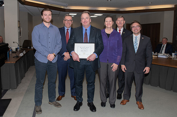 Kudos winner Jeff Culbertson (center) stands with (from left) his son, Lucas Culbertson; Chancellor Ronnie Green; his wife, Lisa Culbertson; Ted Carter, NU-system president; and Keith Ozanne, NU regent. The photo, taken on Feb. 7, 2020, was the only one taken of the 2020 Kudos winners as other NU Regent meetings were held virtually.