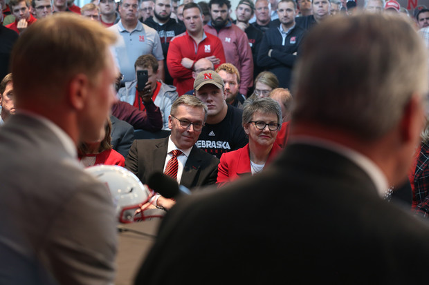 Chancellor Ronnie Green and his wife, Jane, smile as Scott Frost answers questions from the media during a Dec. 3 news conference in Memorial Stadium.
