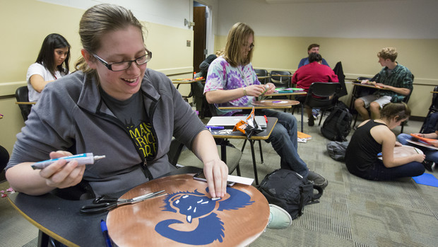 Dorothy Elsken, a senior classics and religious studies major, crafts a shield for the Oct. 31 Battle of Marathon reenactment. Elsken won the shield design contest at the 2015 battle simulation.