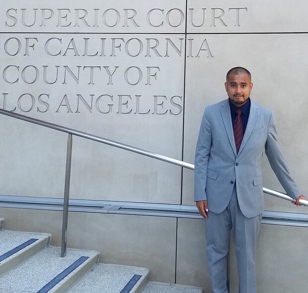 Mauricio Murga Rios stands on the steps of the Los Angeles County's Superior Court of California. In summer 2020, he worked for the immigration unit within Los Angeles County's Public Defender office.
