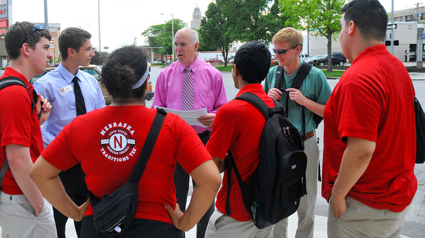 Patrick McBride reviews procedures with the New Student Enrollment parking team outside the 16th and R streets garage on June 6.
