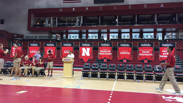Corrie Svehla (left, in blue) helps make final preparations for New Student Convocation in 2017. Svehla, who helps senior administration with technology needs and special events, has worked at Nebraska for nearly 23 years.