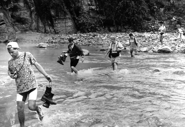 Participants in an Outdoor Adventures trip cross a stream in Colorado in the late 1970s. UNL's Outdoor Adventures program, which started in 1971, is a part of Campus Recreation.