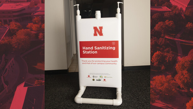 Hand sanitizer stations include signage that notes the donations and partnerships that made the project possible.