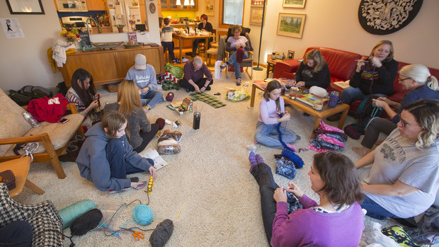 """Scarves for Kids"" volunteers work in Jo Ann Emerson's living room and kitchen. The group is making scarves for students at McPhee Elementary in Lincoln."