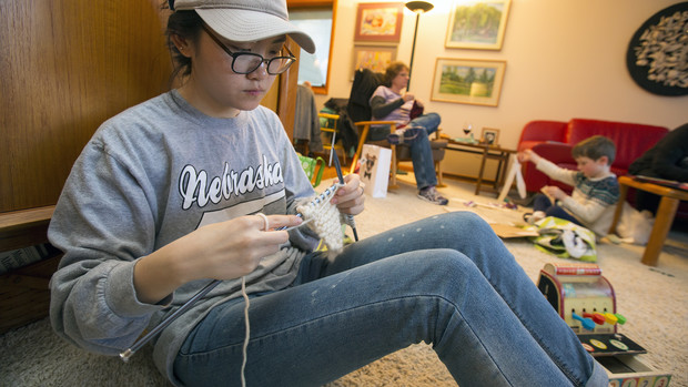 "Yoojeong Lee, a junior from South Korea, was among three Nebraska art students who were among ""Scarves for Kids"" volunteers on Nov. 20."
