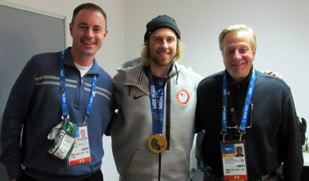 Kevin Kugler (from left) poses with snowboard slopestyle gold medal winner Sage Kotsenberg and fellow Westwood One anchor John Tautges following an interview at the Olympic games in Sochi, Russia.