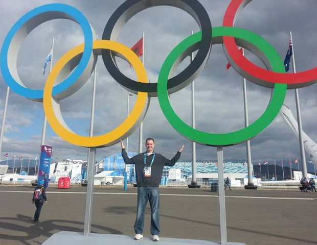 Kevin Kugler poses with the Olympic rings in Sochi, Russia.