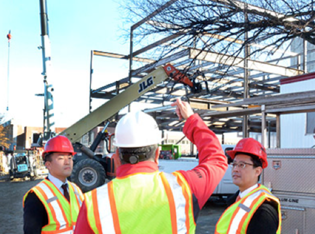 Rik Barrera (center), assistant dean for business, leads (left) Yutaka Takahashi and Yuta Yazawa, both of Senshu University, on a tour of UNL's new College of Business Administration Building.