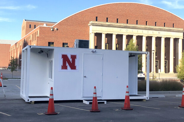 A state-donated testing pod has been moved into position at the random mitigation testing station in the East Stadium Loop. The pod will help keep medical workers warm and allow testing to continue during the winter months. The university is planning to build two more of the pods for use at the TestNebraska site in the 17th and R Street parking garage.