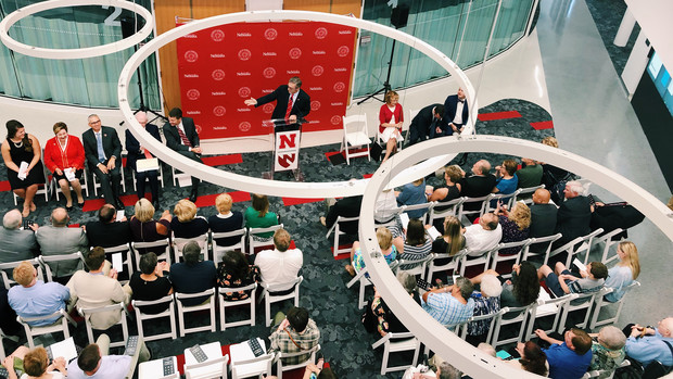 Chancellor Ronnie Green (at podium) gestures during the July 10 open house at the new University Health Center facility. The 107,000-square-foot facility is the new home to the University Health Center and the Lincoln division of the University of Nebraska Medical Center's nursing program.