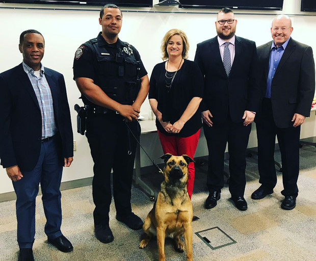 The University Police Department recently presented annual awards to its employees. Pictured (from left) is Hassan Ramzah, assistant chief of police; Russ Johnson, K-9 police officer, and partner, Layla; Gina Hotovy, financial specialist; Zach Fischer, dispatcher; and Owen Yardley, chief of police.