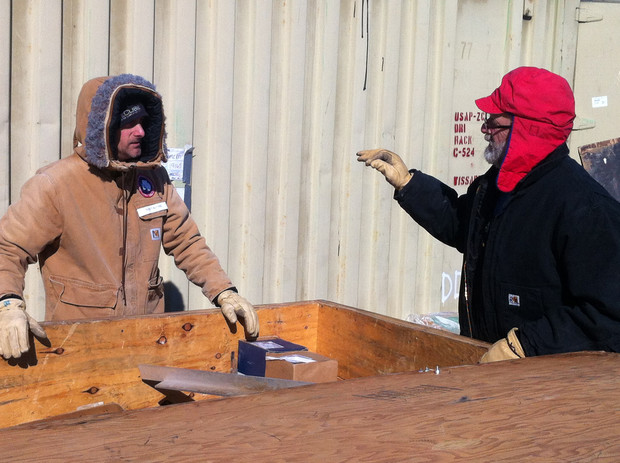 Daren Blythe (left) and Dennis Duling at McMurdo Station, unpacking part of ANDRILL's roving hot-water drill.