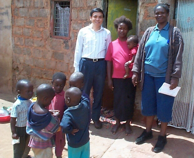 Nebraska's Charles Wood stands with research clients in Zambia.