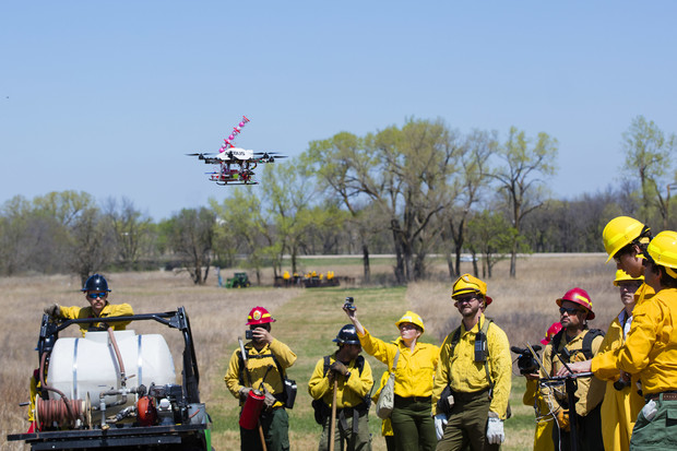 The drone takes off on its fifth flight of the test surrounded by the UNL drone team, media and firefighters.