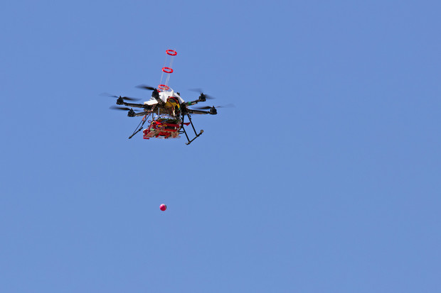 The drone drops a fire ball during the April 22 test. The device was the fourth prototype developed by UNL's Sebastian Elbaum and Carrick Detweiler; a couple more versions are likely within the next couple years. The drones previously had been tested indoors and on private land.